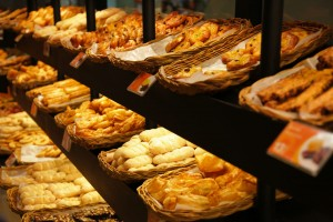 Various bread type on shelf in Bakery shop.